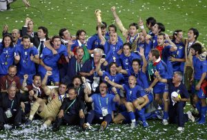 9 July 2006: Italian players celebrate with the World Cup trophy after the FIFA World Cup Final between France and Italy played at the Olympiastadion in Berlin. Italy won the game 5-3 on penalties after the game finished 1-1 after extra time   soccer football  060709 joy celebrate celebration winner trophy trophies