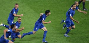 Italian players run after Fabio Grosso scored the final goal of the penalty shotout during the World Cup 2006 final football game France vs Italy, 09 July 2006 in Berlin at the Olympic Stadium. Italy won 5-4 and obtained the 2006 World Cup. AFP PHOTO  VALERY HACHE