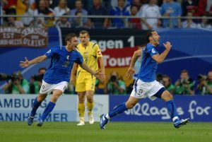 Italy's Gianluca Zambrotta (r) celebrates scoring the opening goal with Francesco Totti (l)