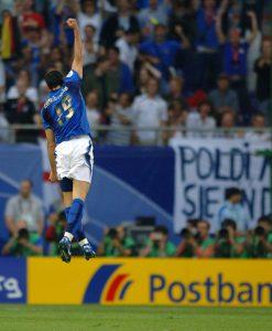 Italy's Gianluca Zambrotta celebrates scoring the opening goal
