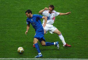 Italy's Gianluca Zambrotta and France's Franck Ribery